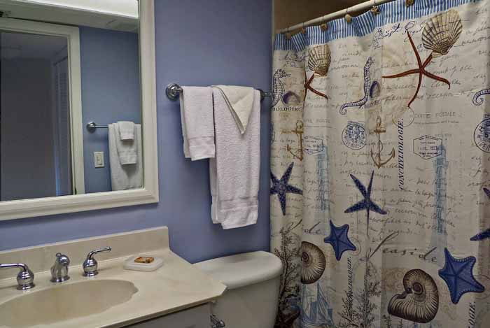 Gulf Beach #103 Guest Bathroom with Shower, Tub, and Hairdryer